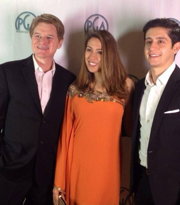 Steve Brewster, Grace Santos, Wesam Keesh accepting an Honorable Mention by the Producers Guild of America for their film Spun
